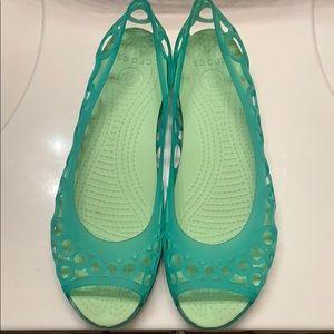 Comfortable teal and green Crocs